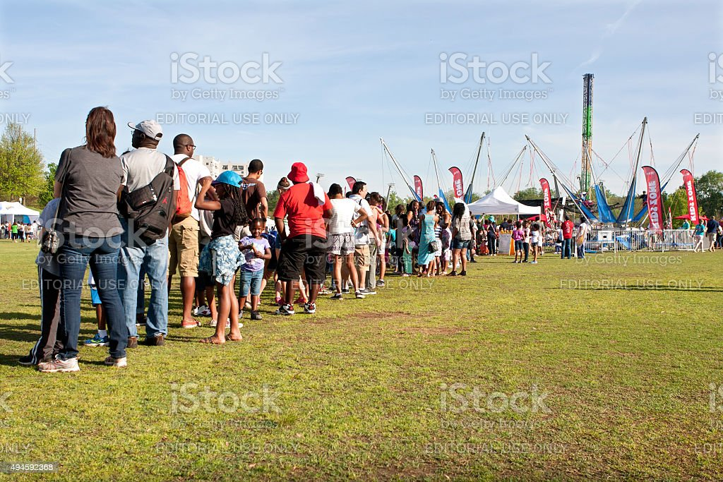 Families Stand In Long Line Waiting For Atlanta Festival Ride stock photo