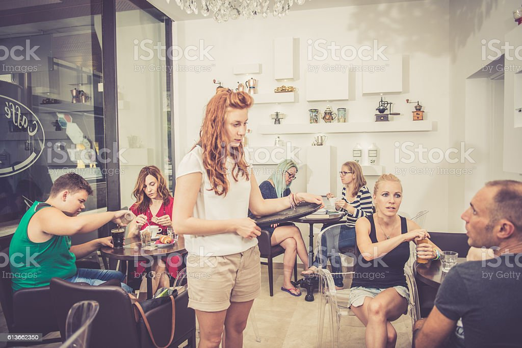 Families, Students and Waitress at Coffee Bar Cafe Trieste, Europe stock photo