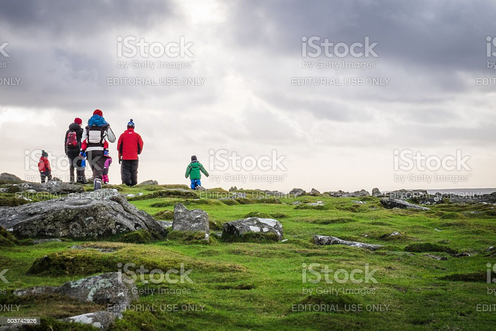 Families walks across Dartmoor, Plymouth, on a cold, cloudy day stock photo