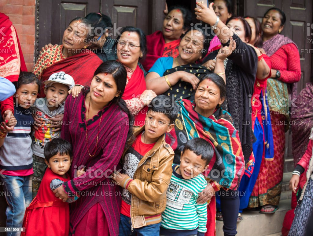 Families watching a passing ceremony procession. stock photo