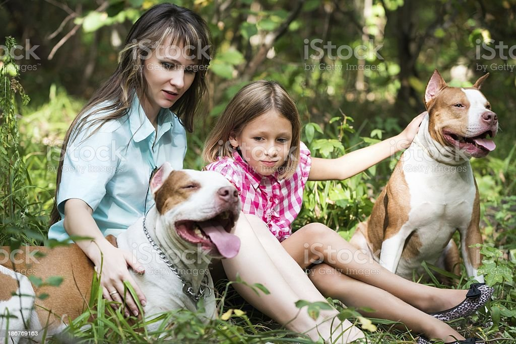 Families with dogs royalty-free stock photo