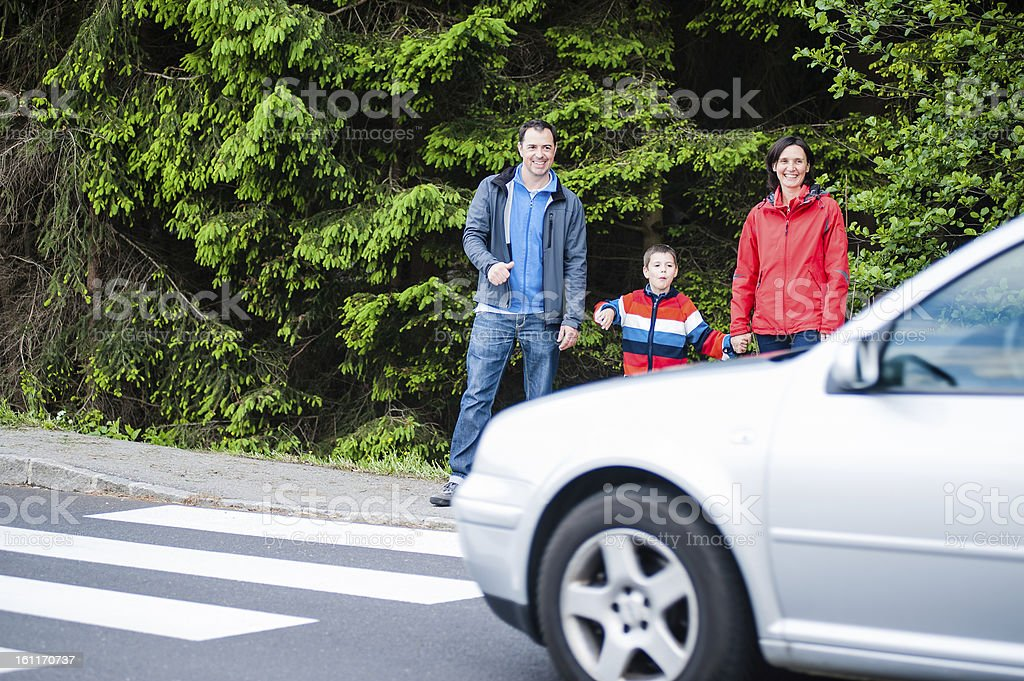Familiy waiting by the Crosswalk stock photo