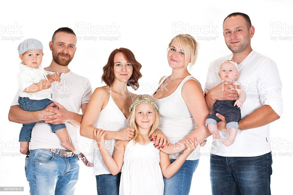 family, a group of people in white shirts and jeans stock photo
