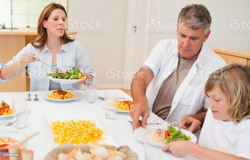Family about to start dinner stock photo