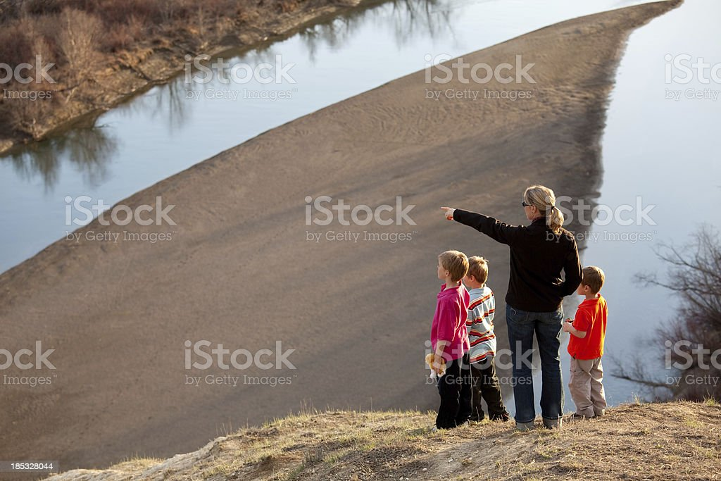 Family Admiring A Beautiful Valley View royalty-free stock photo