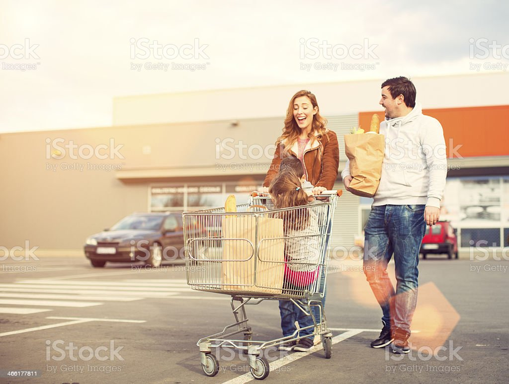 Family after shopping on parking lot. stock photo