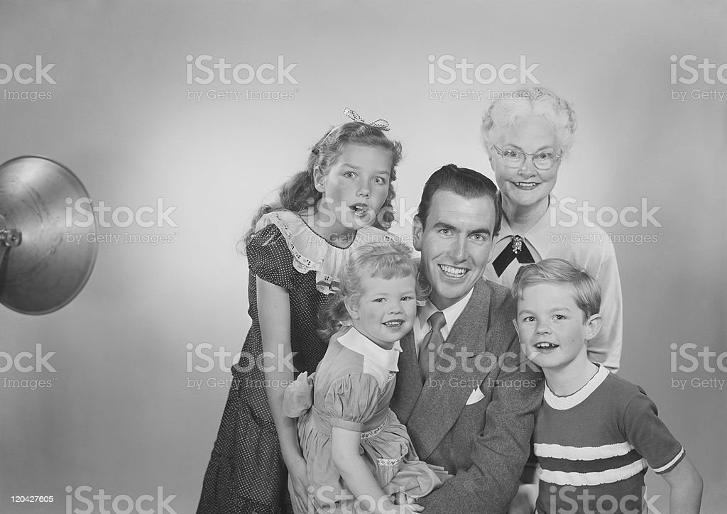 Family against white background, smiling, portrait stock photo