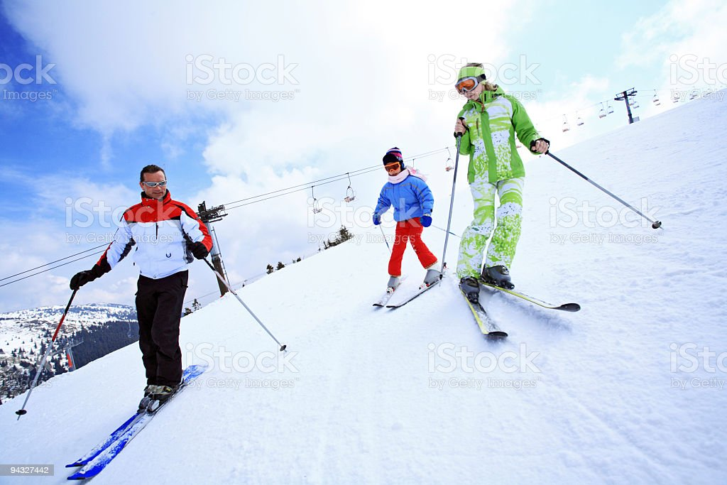 Family all together skiing. royalty-free stock photo