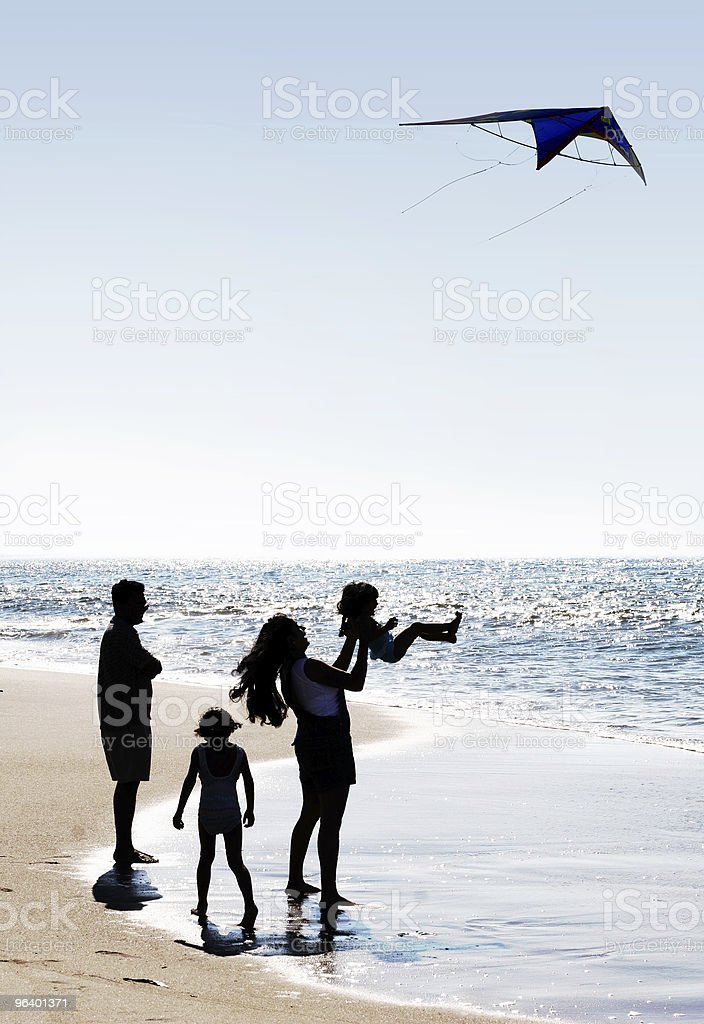 Family and a kite royalty-free stock photo