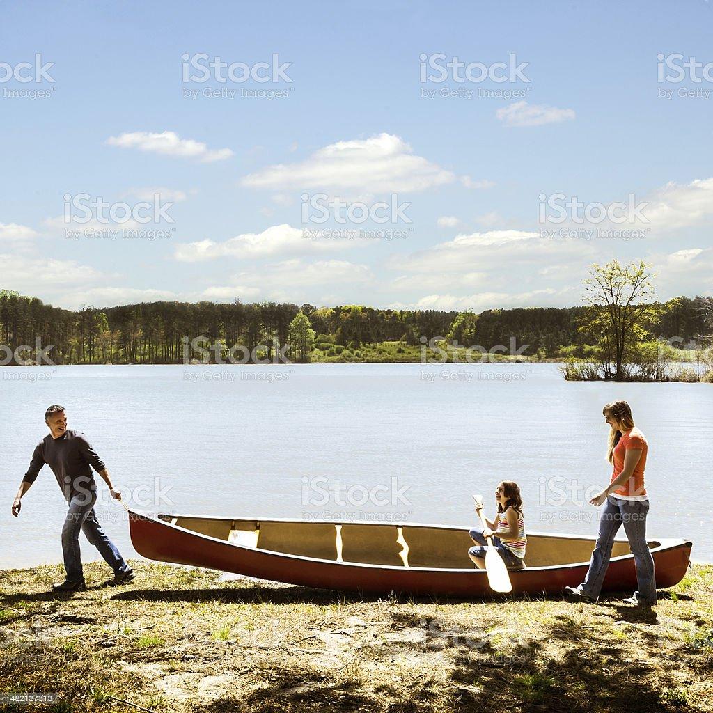 Family and Canoe royalty-free stock photo