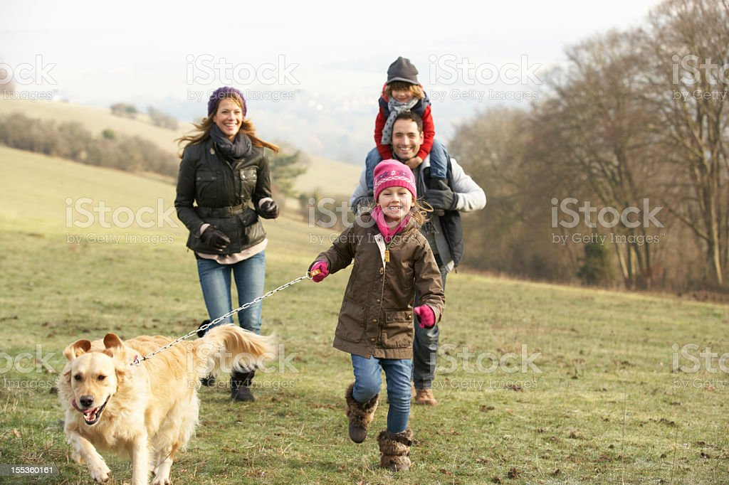 Family and dog on country walk in winter royalty-free stock photo