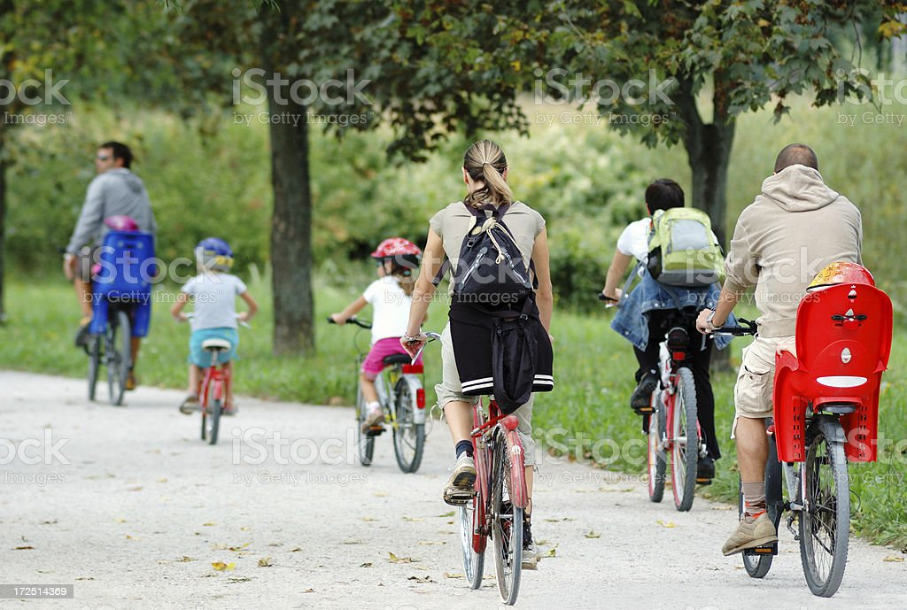 Family and friends cycling stock photo