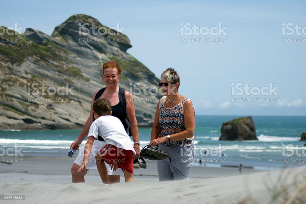 Family and Friends on the Beach. stock photo