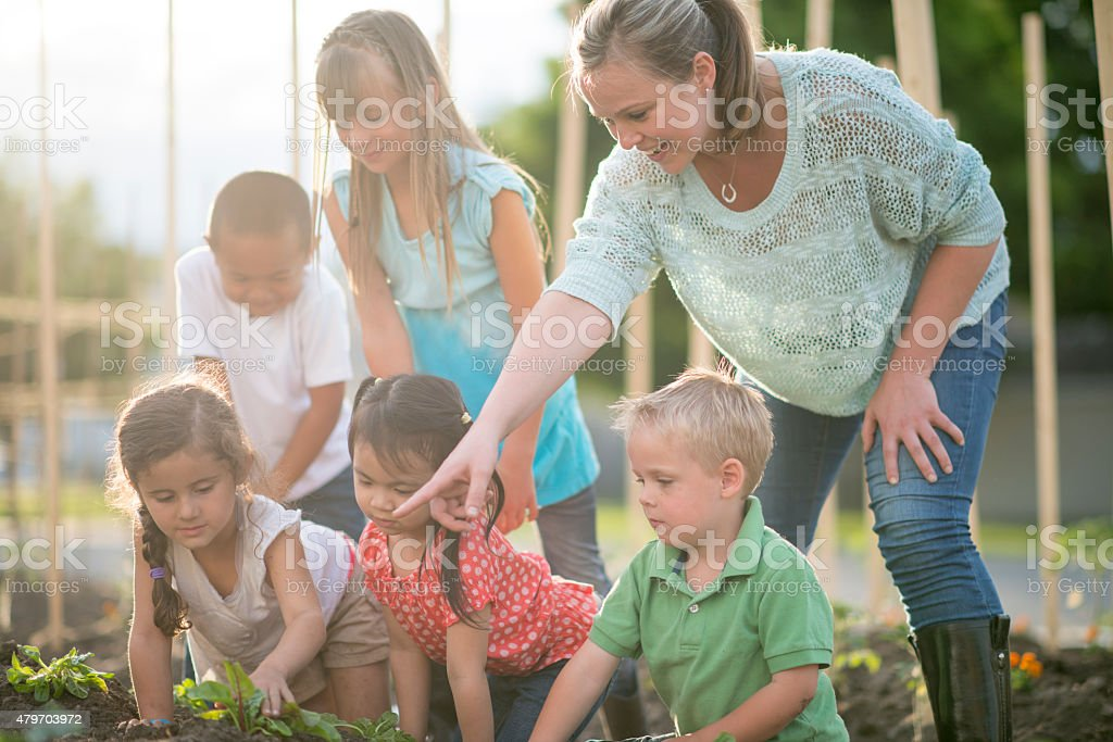 Family and Friends Spring Gardening stock photo