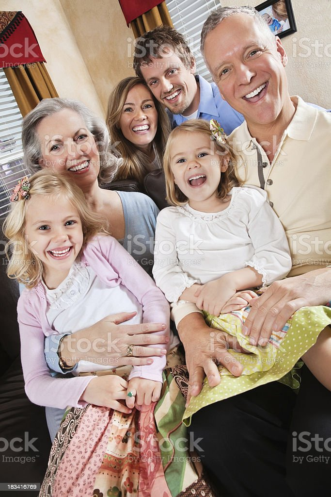 Family And Grandparents Enjoying Time Together in Living Room royalty-free stock photo