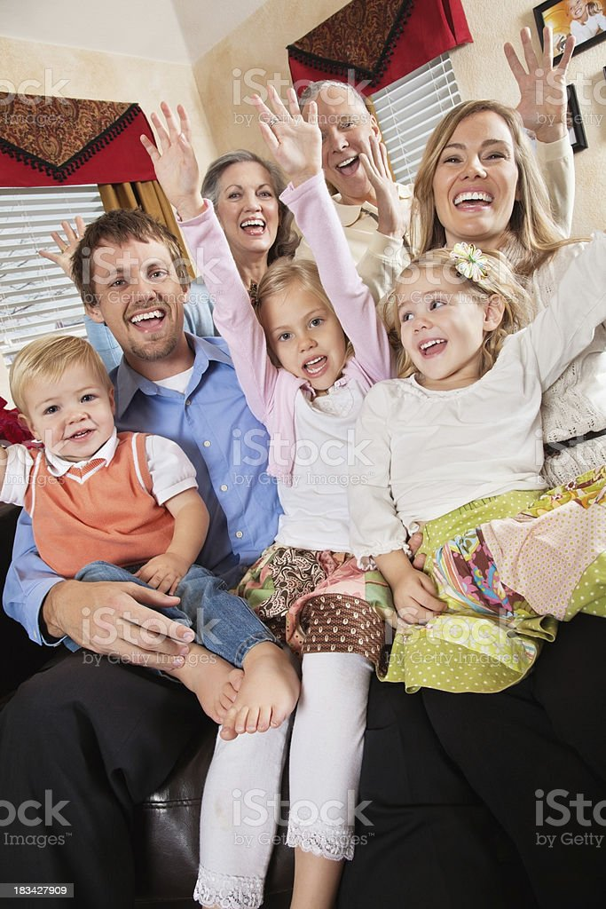 Family and Grandparents Excited With Arms Up in Living Room royalty-free stock photo