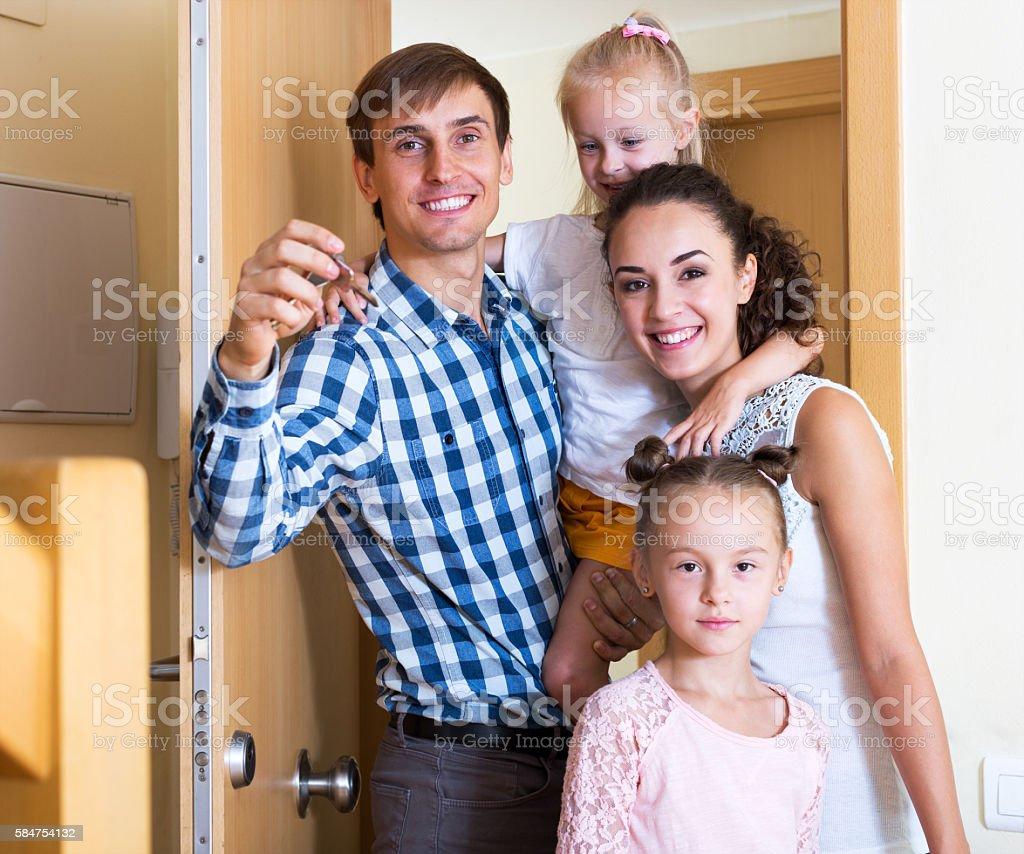 Family and keys new apartment stock photo