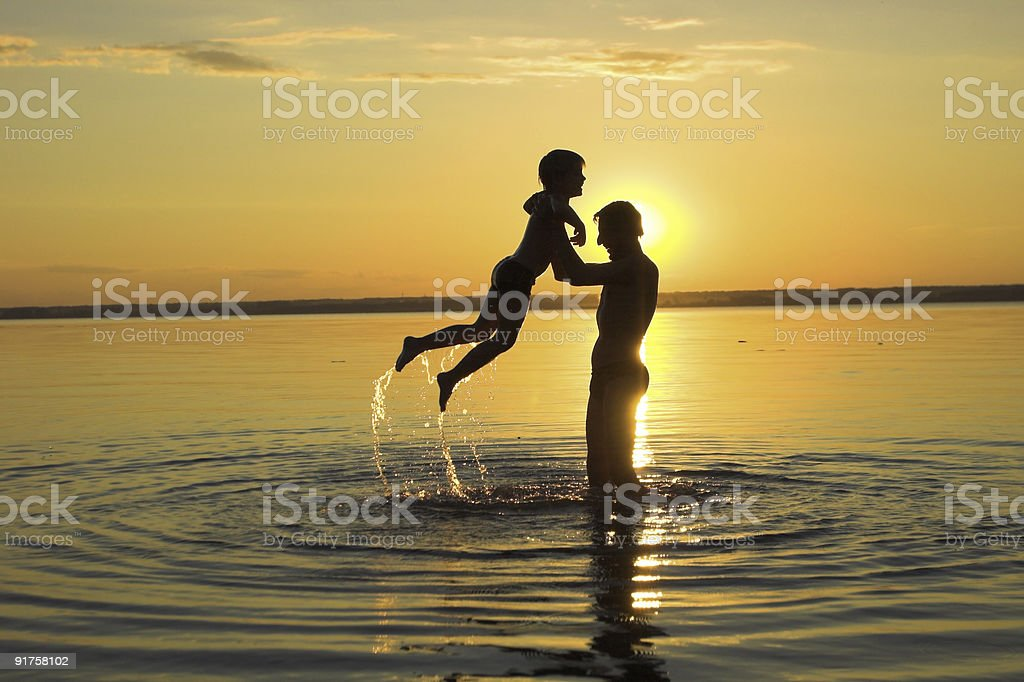family and sunset royalty-free stock photo
