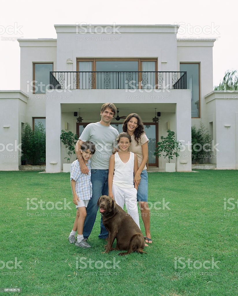 Family and their dog in the garden stock photo