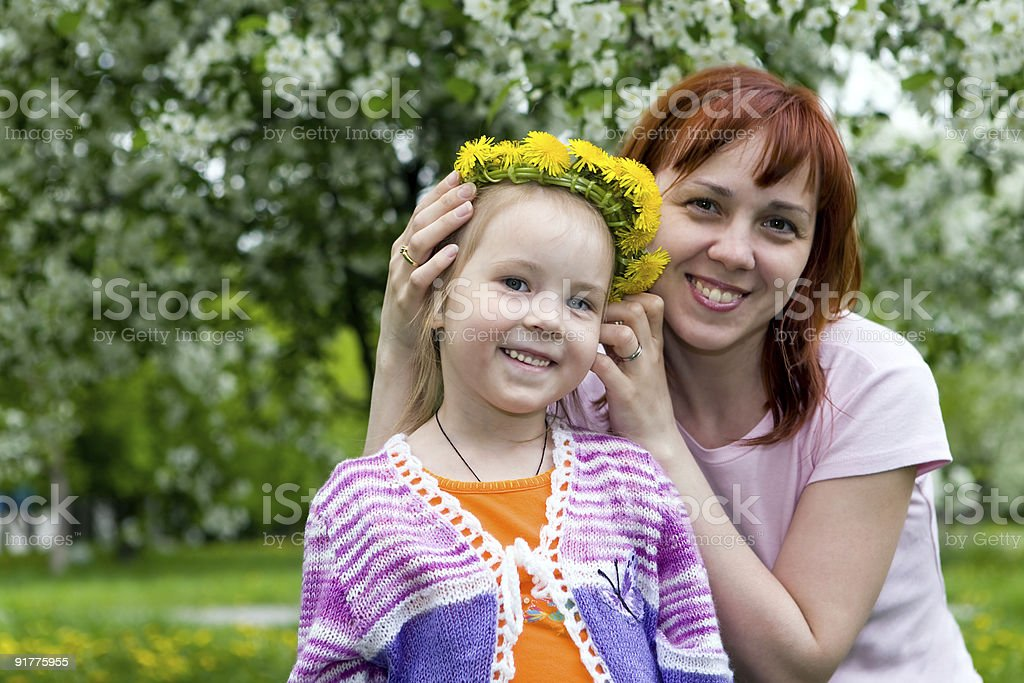 Family and wreath from dandelions royalty-free stock photo