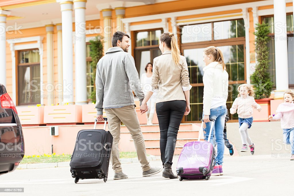 Family arriving at the hotel royalty-free stock photo