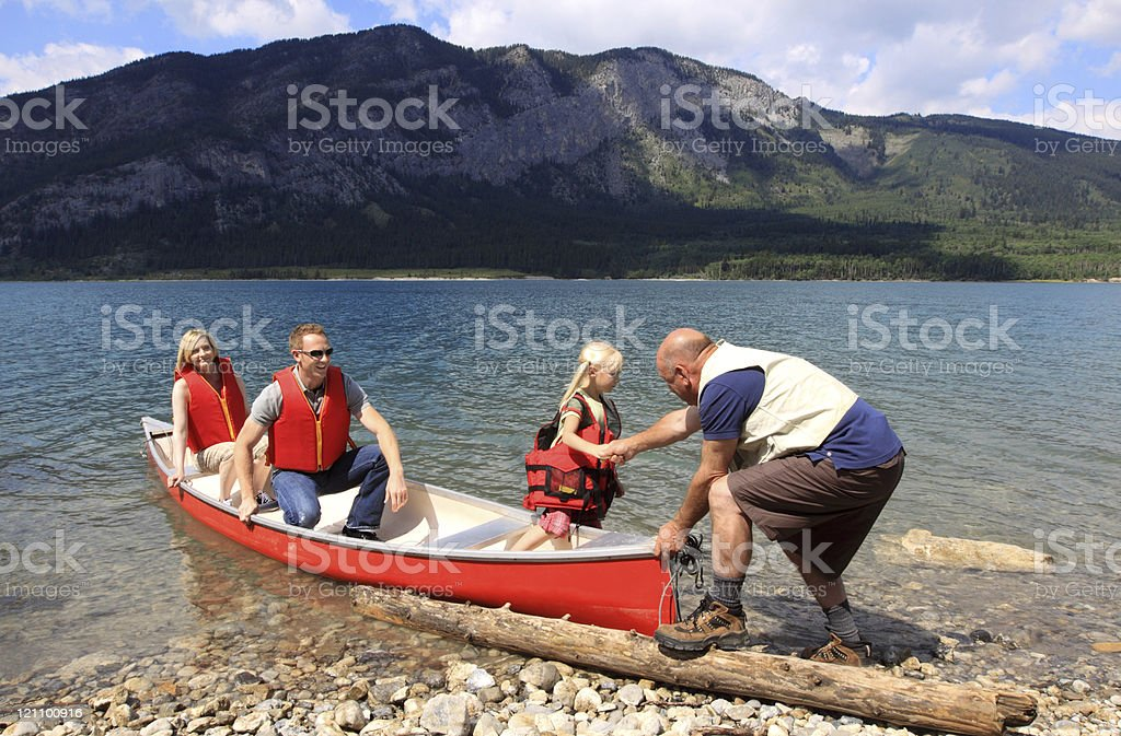 Family arriving from a boat trip royalty-free stock photo