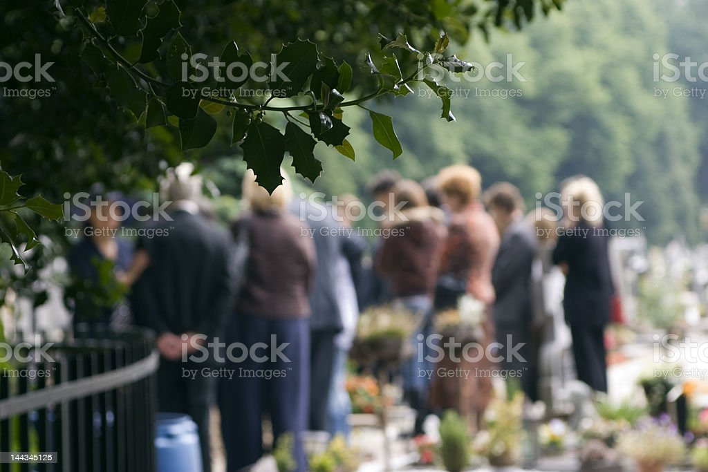 Family at a burial stock photo