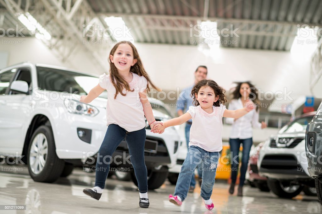 Family at a car dealership stock photo