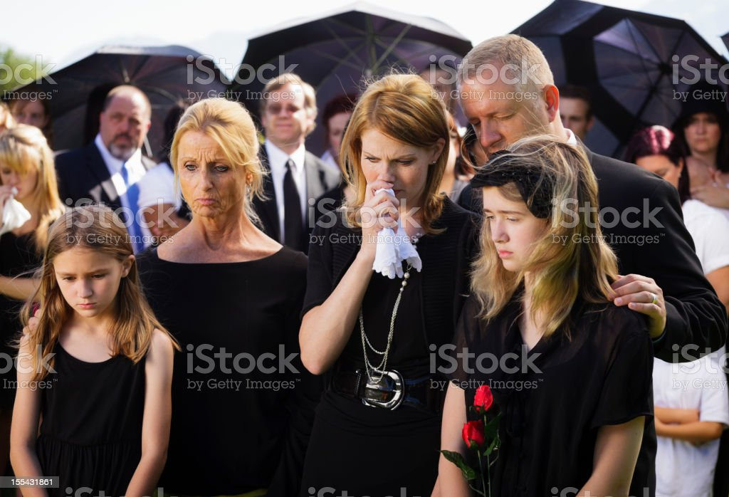 Family at a Funeral stock photo