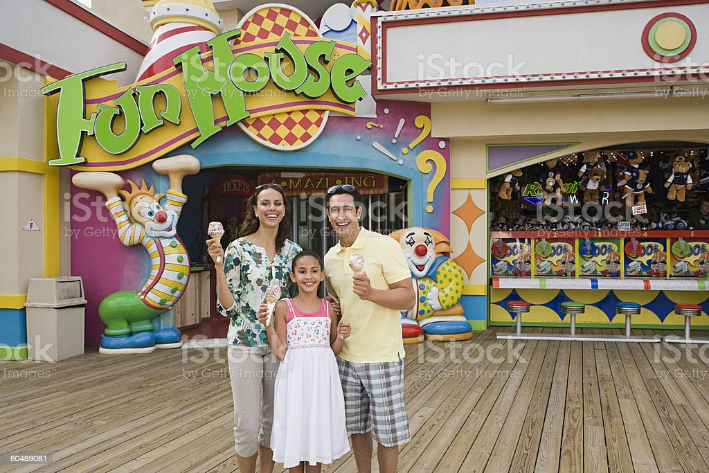 Family at amusement park stock photo