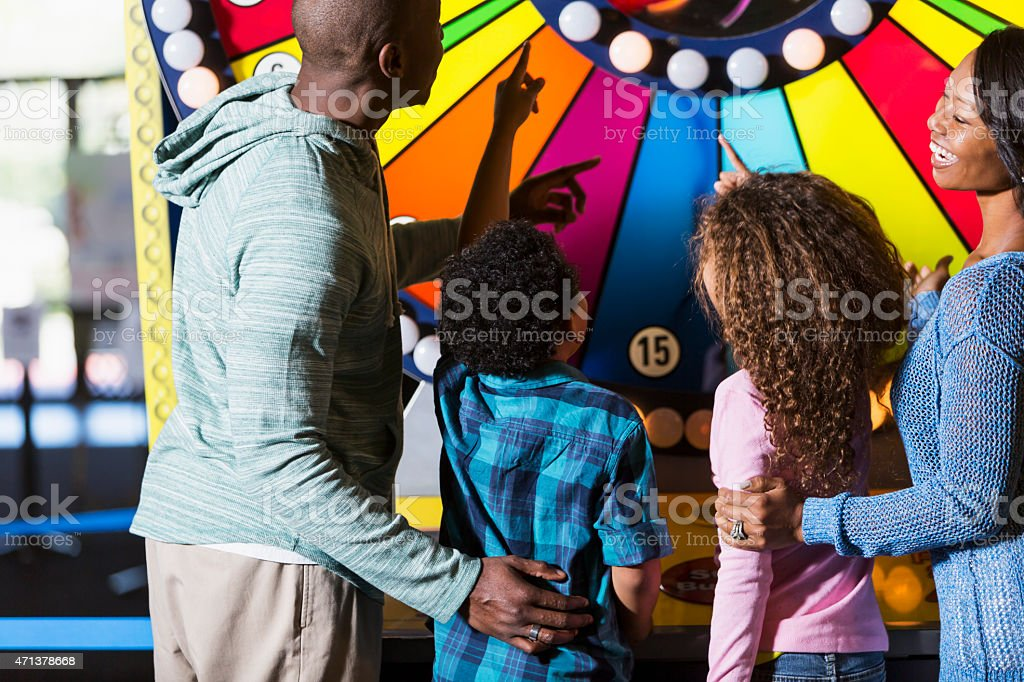Family at an amusement arcade stock photo