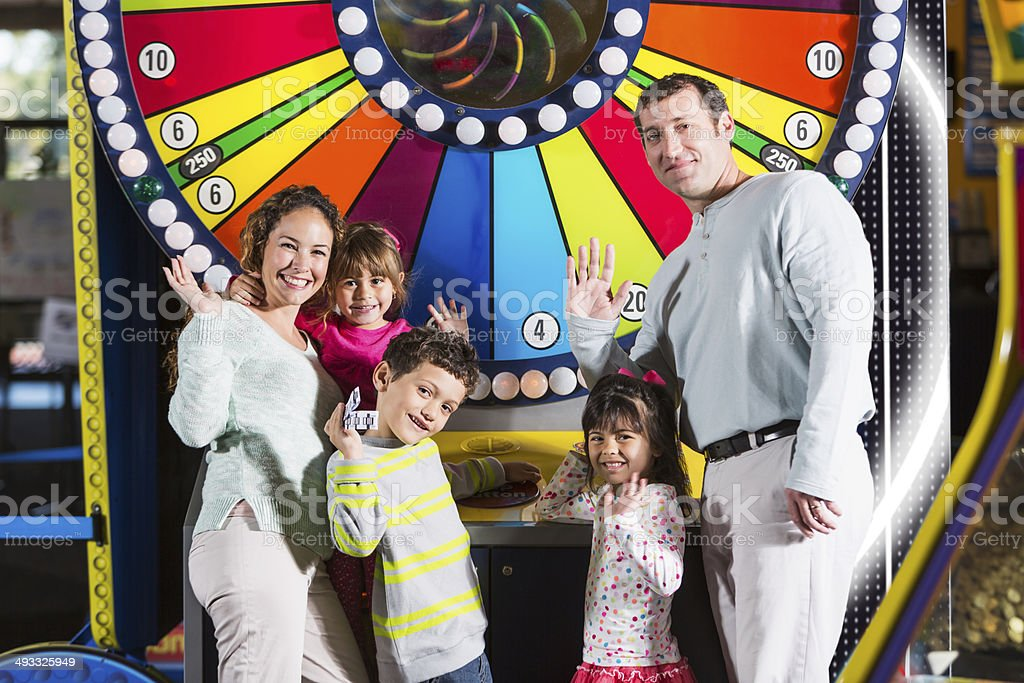 Family at an amusement arcade stock photo