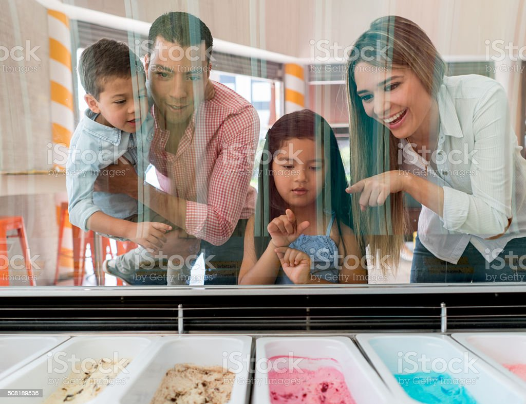Family at an ice cream shop stock photo