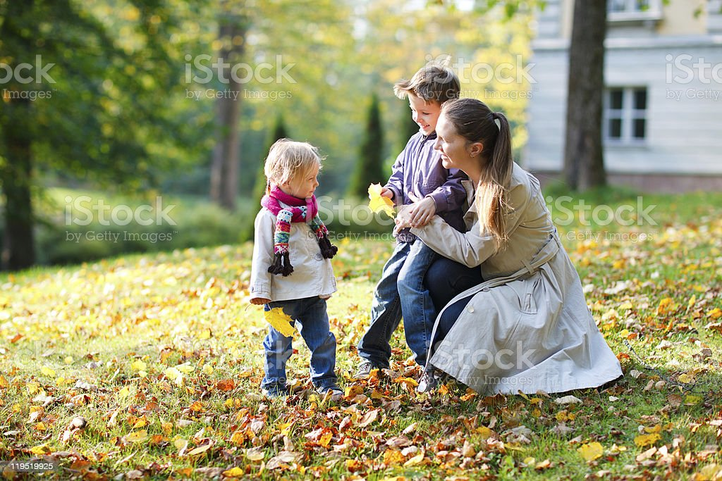 Family at autumn park royalty-free stock photo