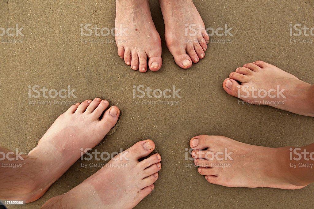 family at beach stock photo