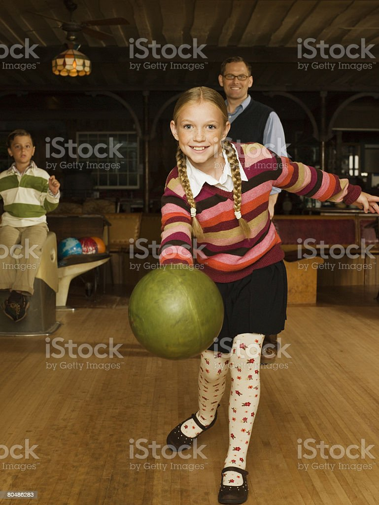 Family at bowling alley royalty-free stock photo