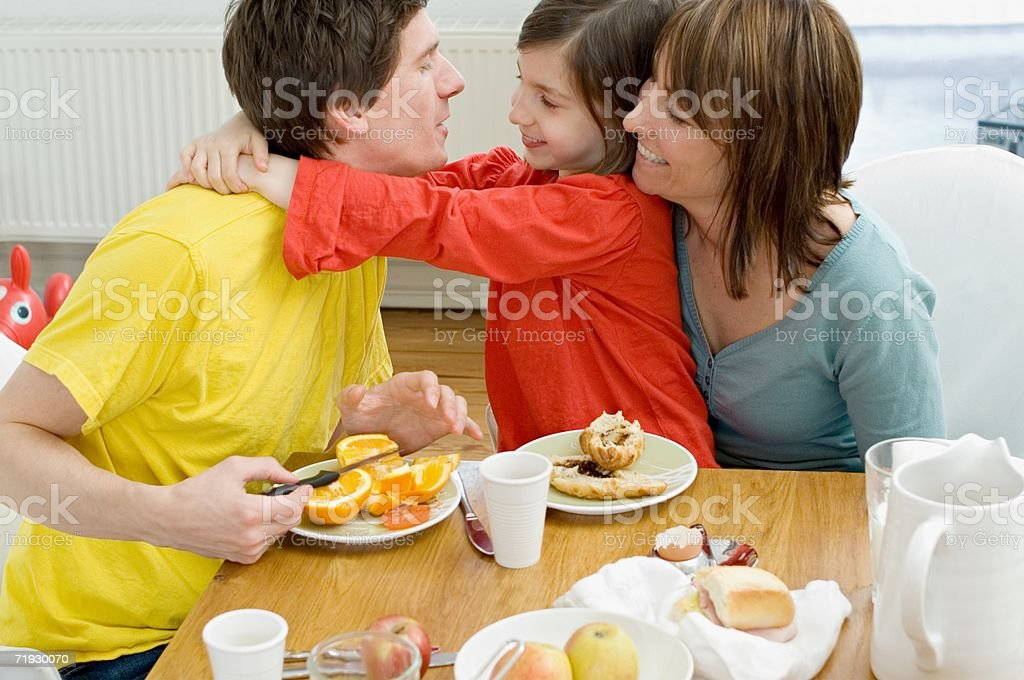 Family at breakfast table royalty-free stock photo