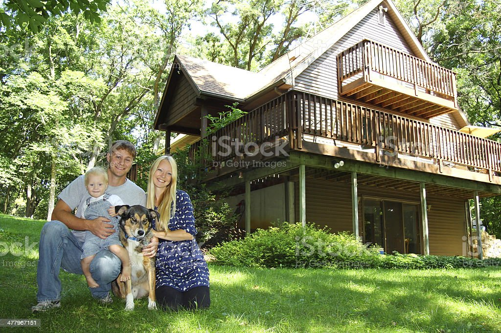 Family at Cabin in Woods royalty-free stock photo