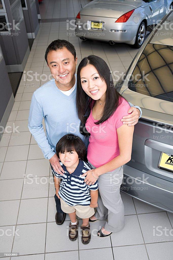 Family at car dealership royalty-free stock photo