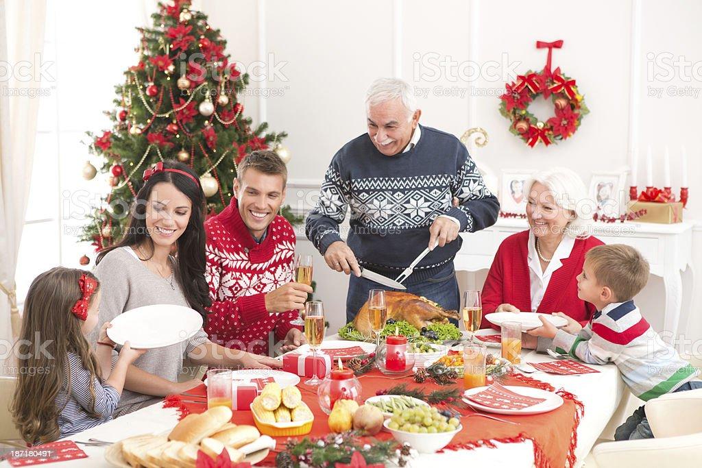 Family at christmas dinner. stock photo