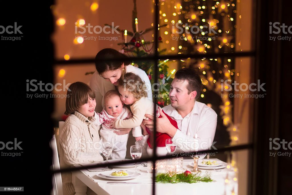 Family at Christmas dinner stock photo