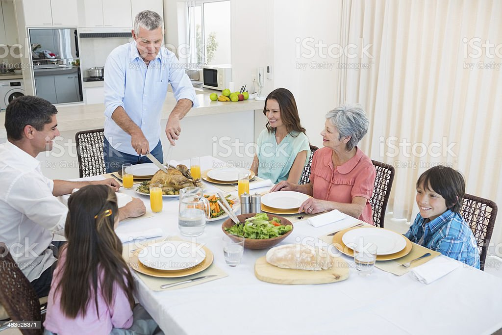 Family at dining table for christmas dinner royalty-free stock photo