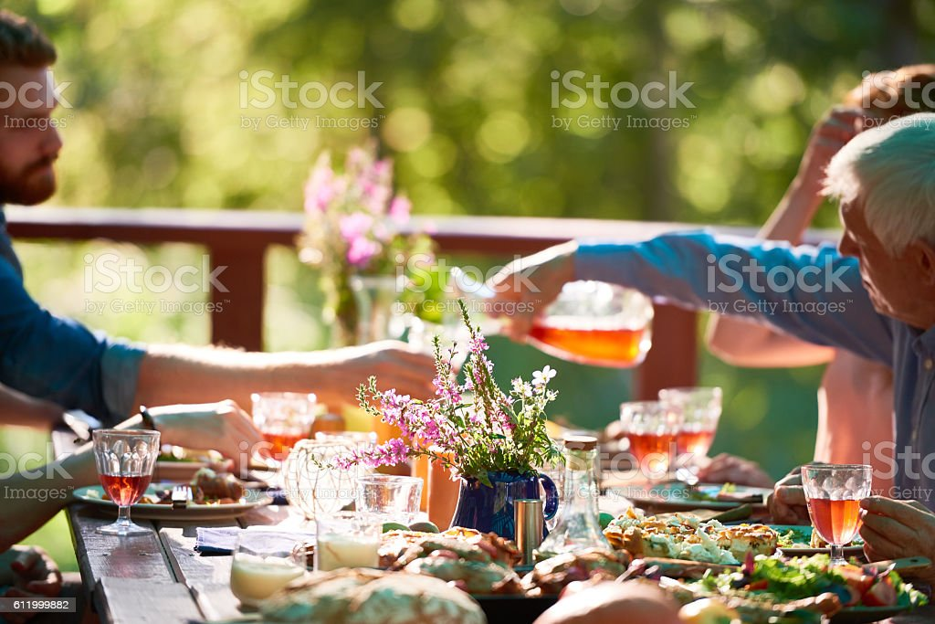 Family at dining table stock photo