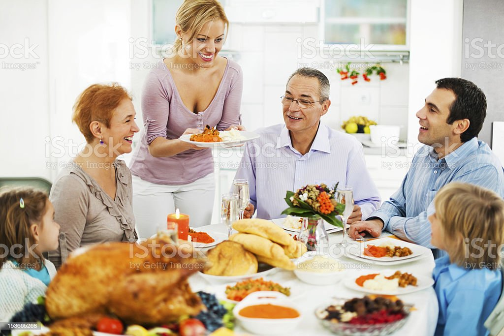 Family at dinner table for the Thanksgiving day. royalty-free stock photo