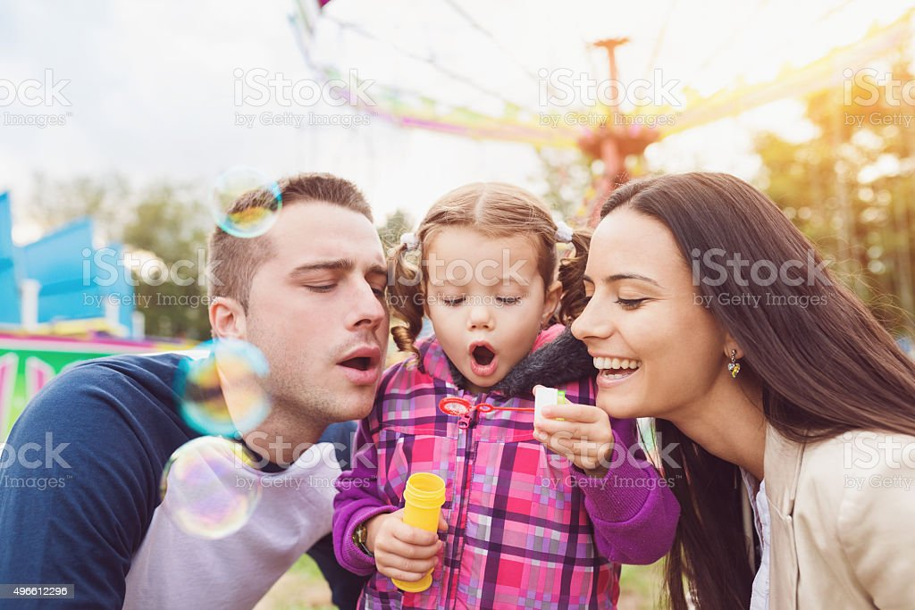 Family at fun fair stock photo