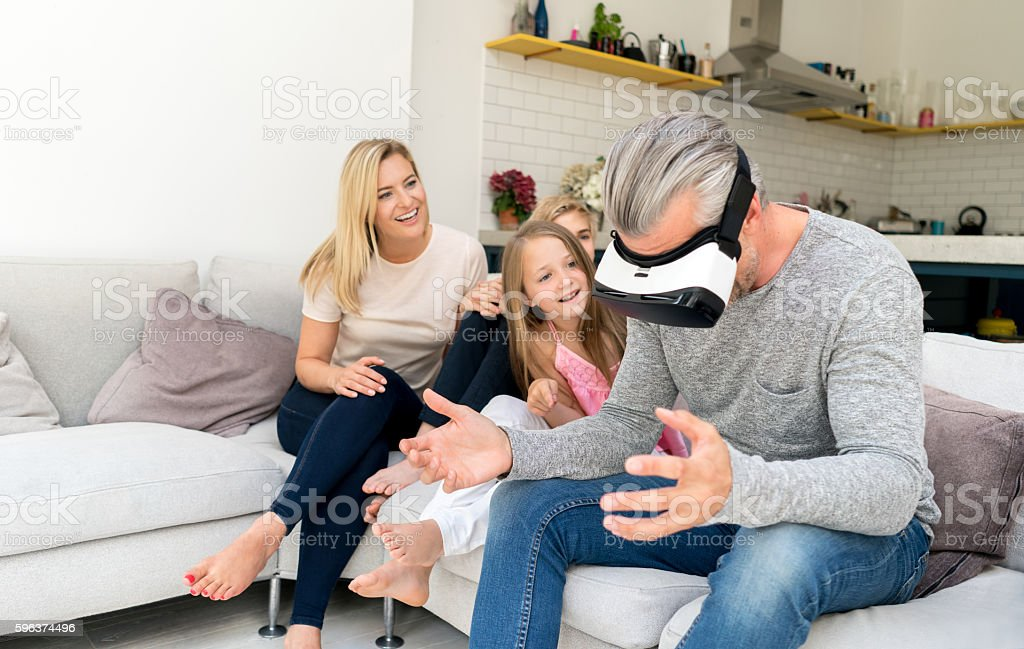Family at home trying a VR device stock photo