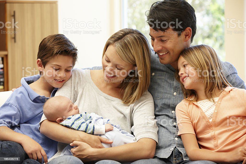 Family at home with new baby stock photo