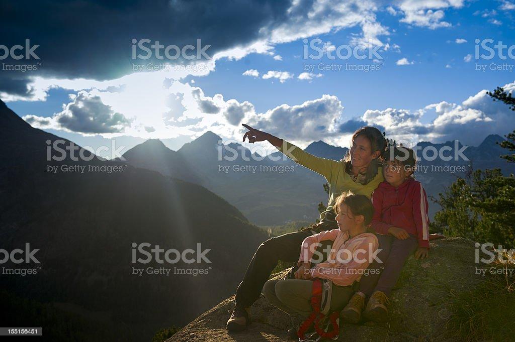 Family at mountain sunrise royalty-free stock photo