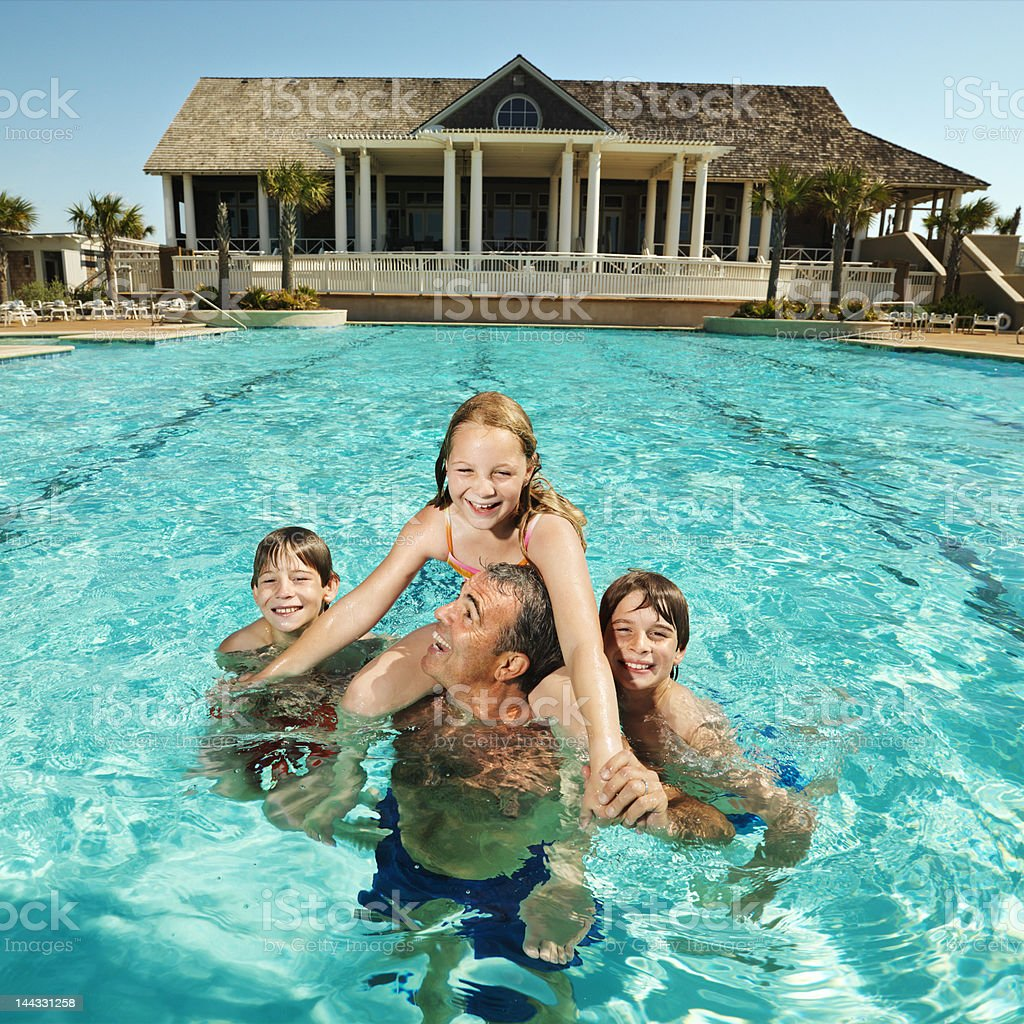 Family at pool. stock photo