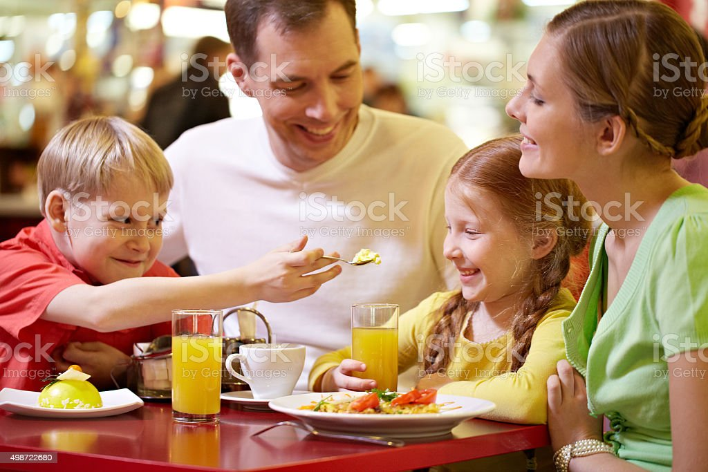 Family at restaurant stock photo